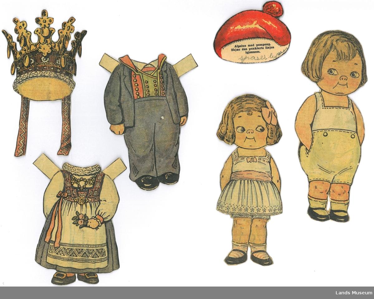 Gutt og jente med bunad, jenta har brudekrone og gutten rød lue.
