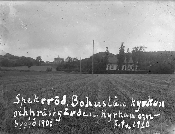 """Enligt text på fotot: """"Spekeröd, Bohuslän, Kyrkan och prästgården, Kyrkan ombyggd 1905. Foto. 1920""""."""