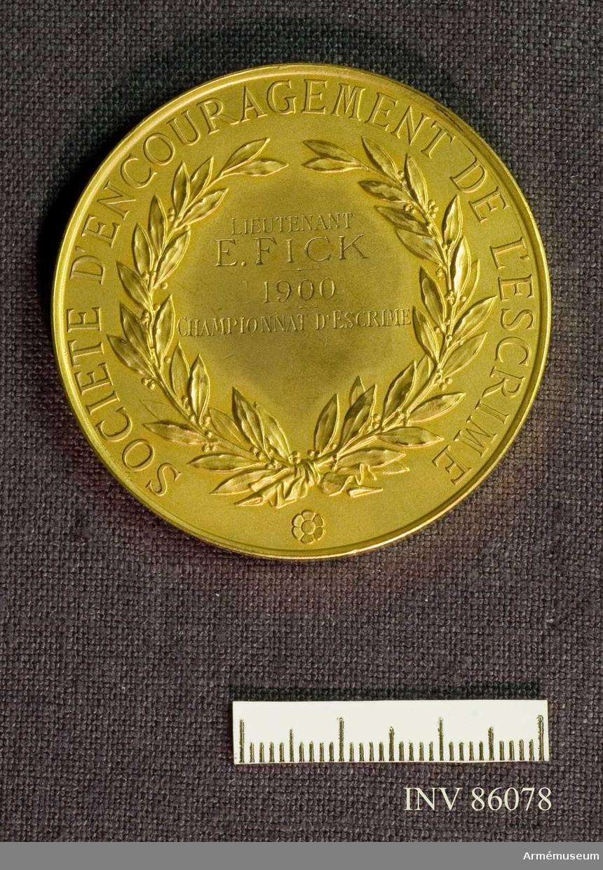 Grupp M II.  Guldmedalj. Societé d´encouragement de léscrime Lieutenant E.Fick 1900. Championnat d´Escrime. Signerad P. Tasset. BRONZE.