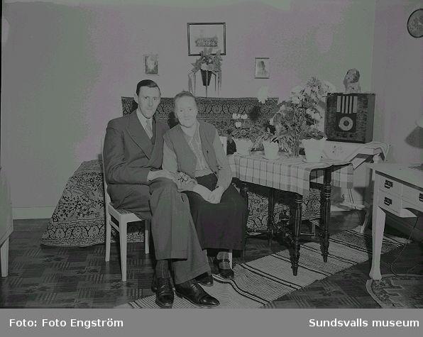 Porträtt, man och kvinna i rumsmiljö.