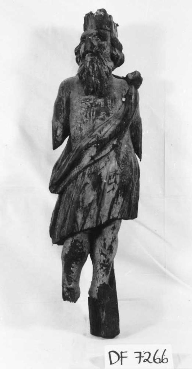 Mannsfigur, skulpturrelieff.
