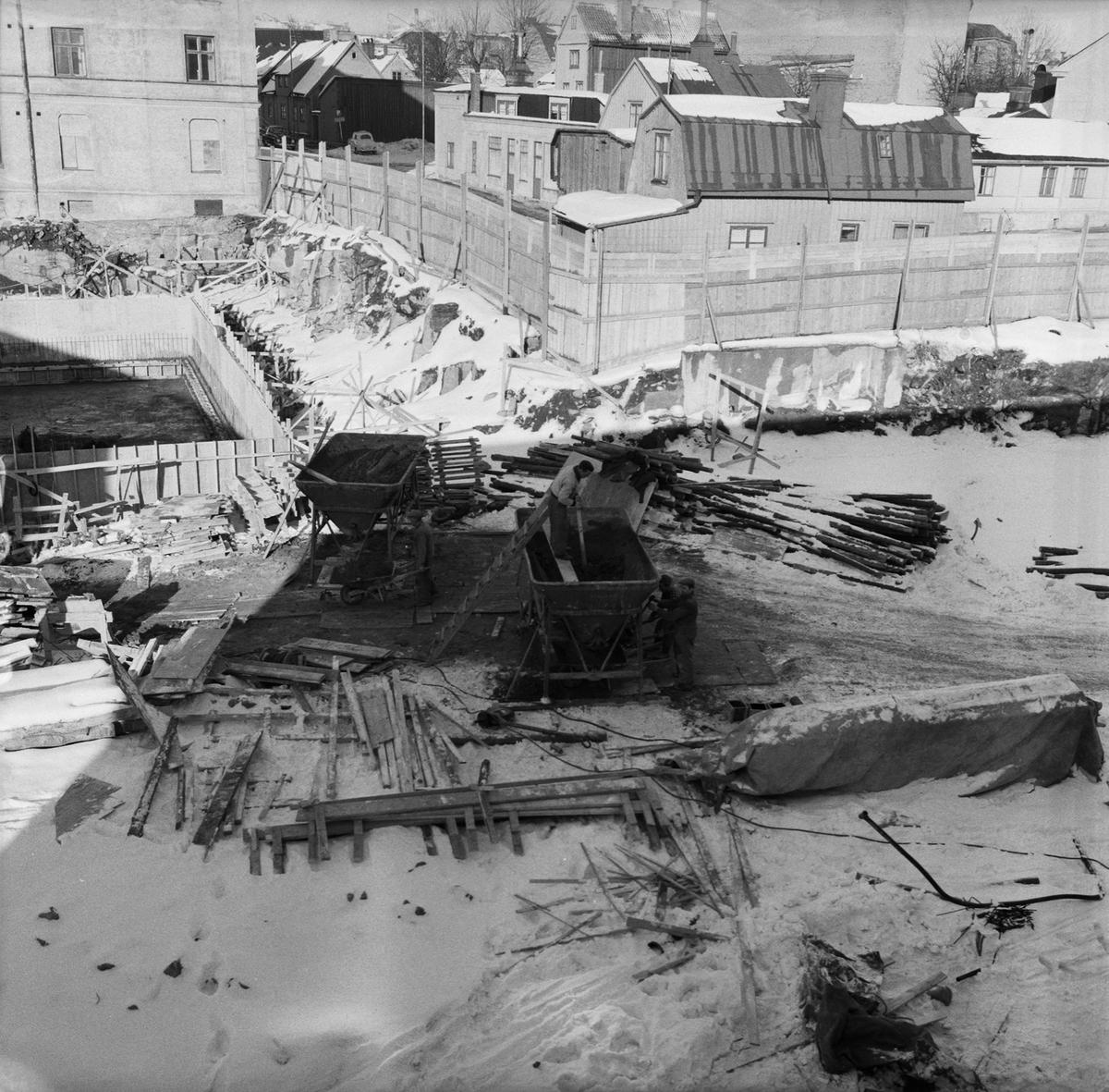 Övrigt: Fotodatum:22/2 1963. Byggnader och Kranar. Nyb området värmecentralen gjutning
