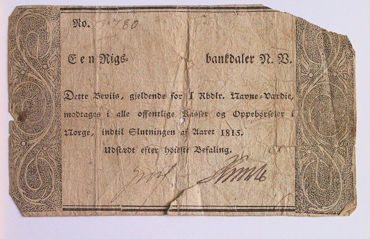 Seddel fra Kongelig Regjeringskommisjon, Christiania. Seddel 12 Skilling. 12 Skilling.  Vannmerke vanskelig å se, da seddelen er krøllet.