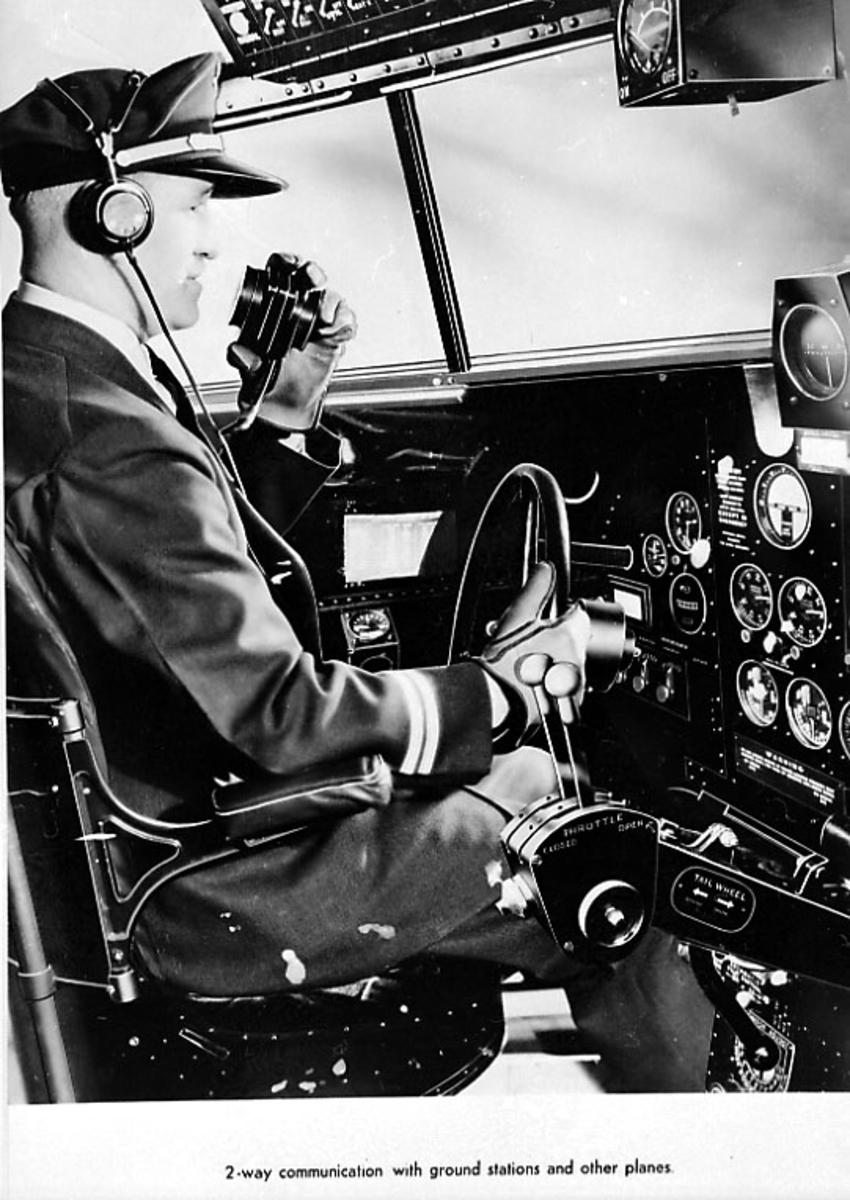 Div. reklame og opplysninger om TWA - illustrert med bilder, skisser og tekst. Pilot i cockpit - kommuniserer.