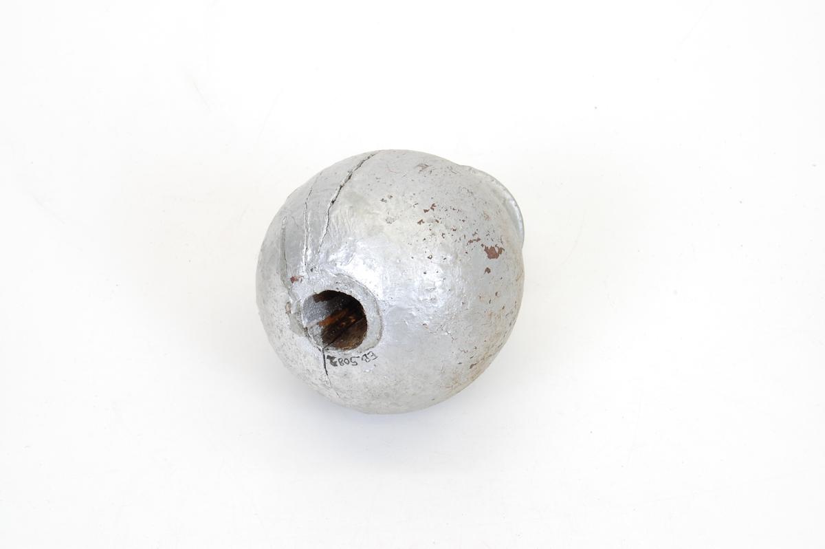 Form: kuleformet med liten spirformet topp