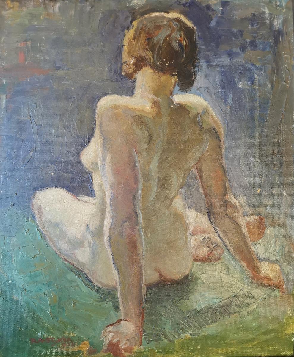 Akt. Sittende kvinne med ryggen vendt mot betrakteren.