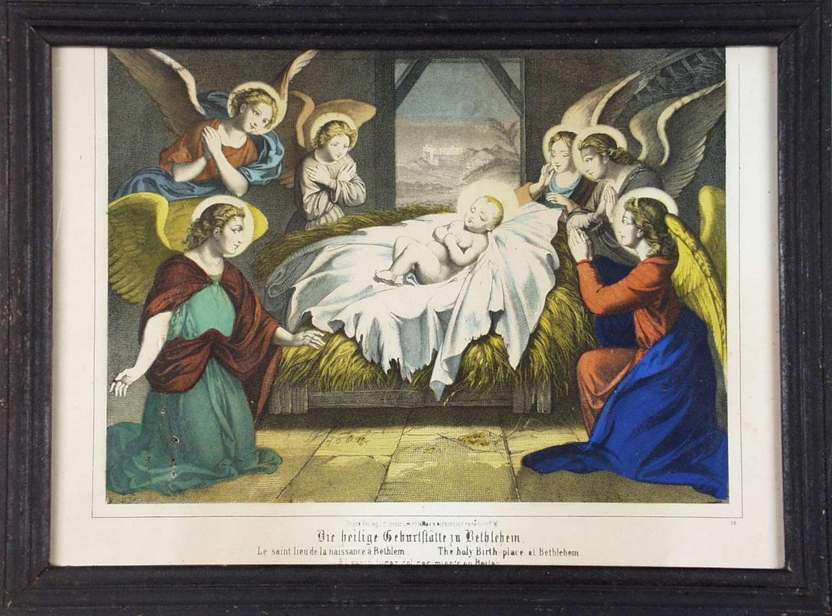 Nyfødte Jesus i stallen omgitt av engler.