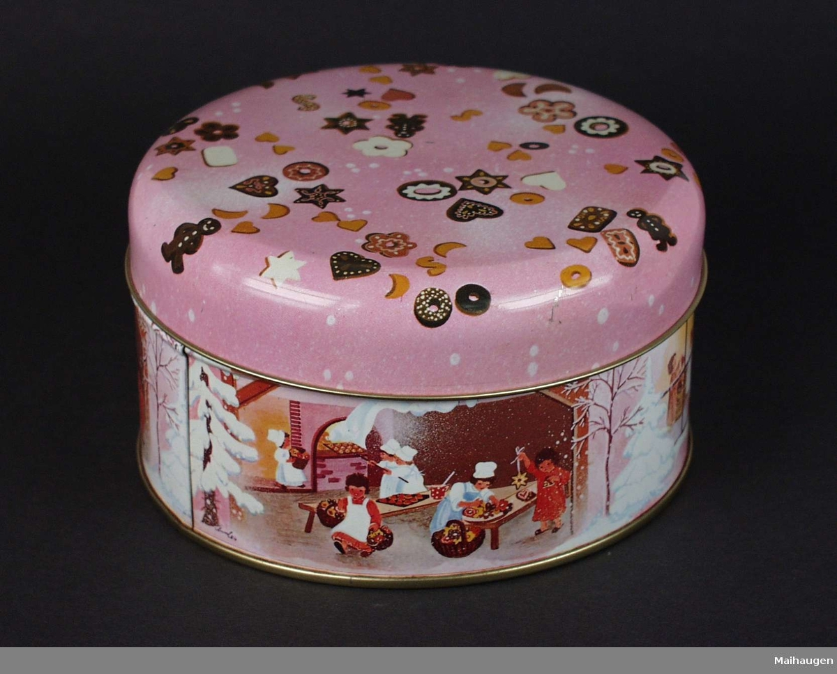 Rund rosa kakeboks med julemotiv.