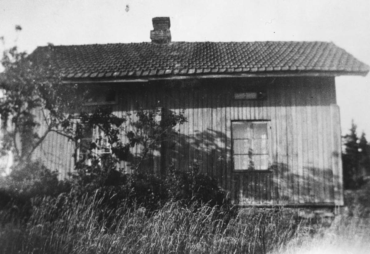 Bilde av et gammelt hus.