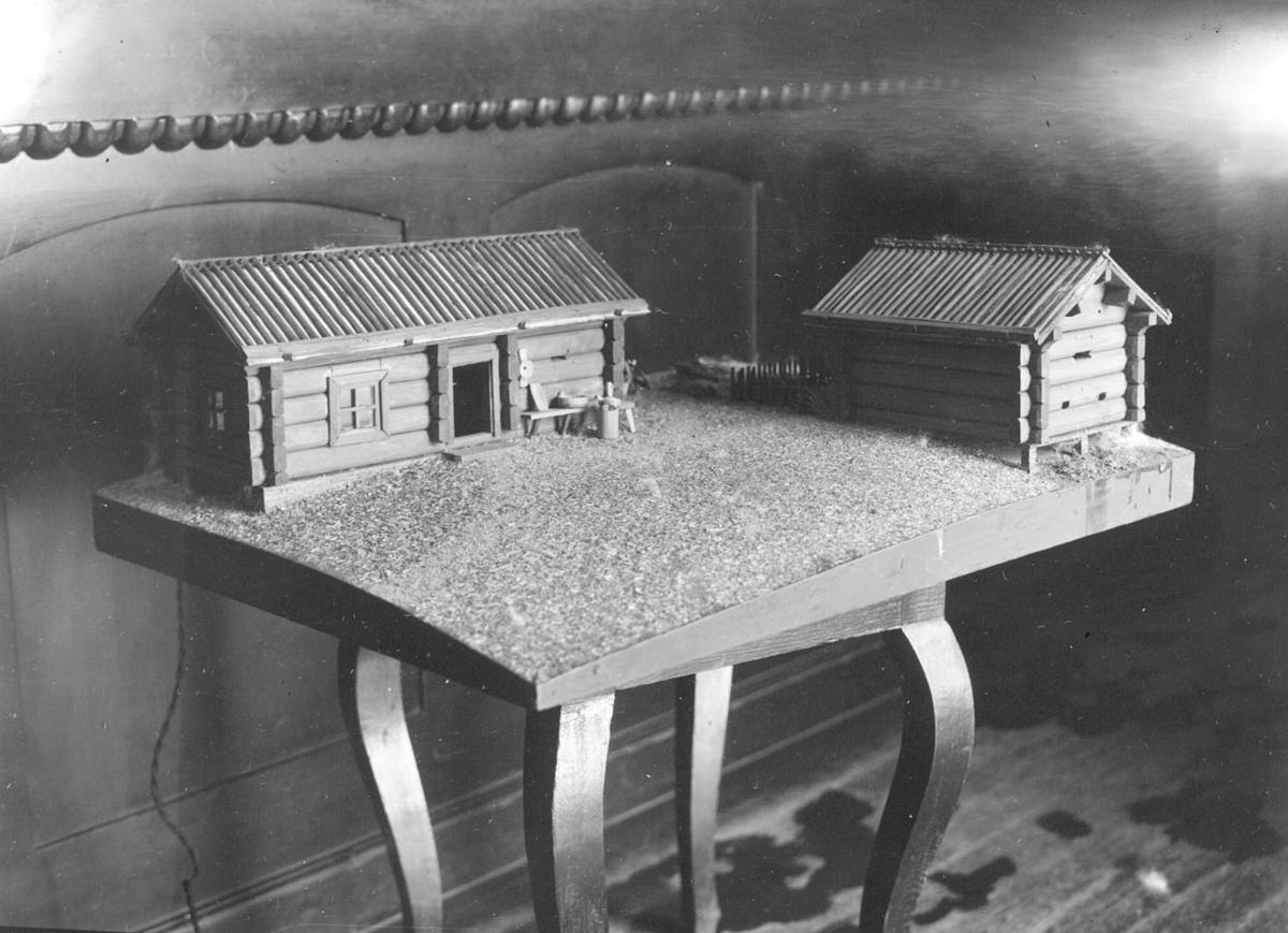 Modell av tømmerhus