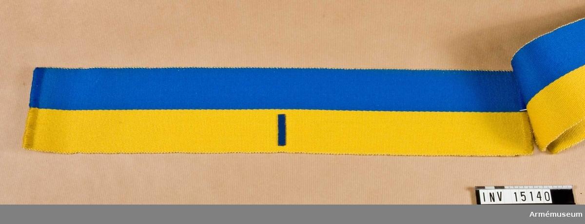 Grupp C I. Armbindel för fältpolisen m/1898. Blå och gul. Märkt I.
