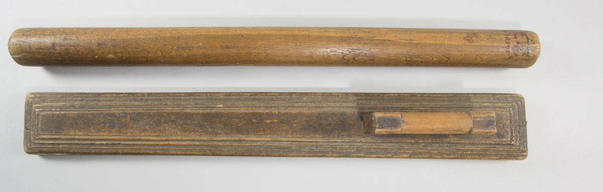 Kaveldon, bestående av mangelbräde och kavel.
