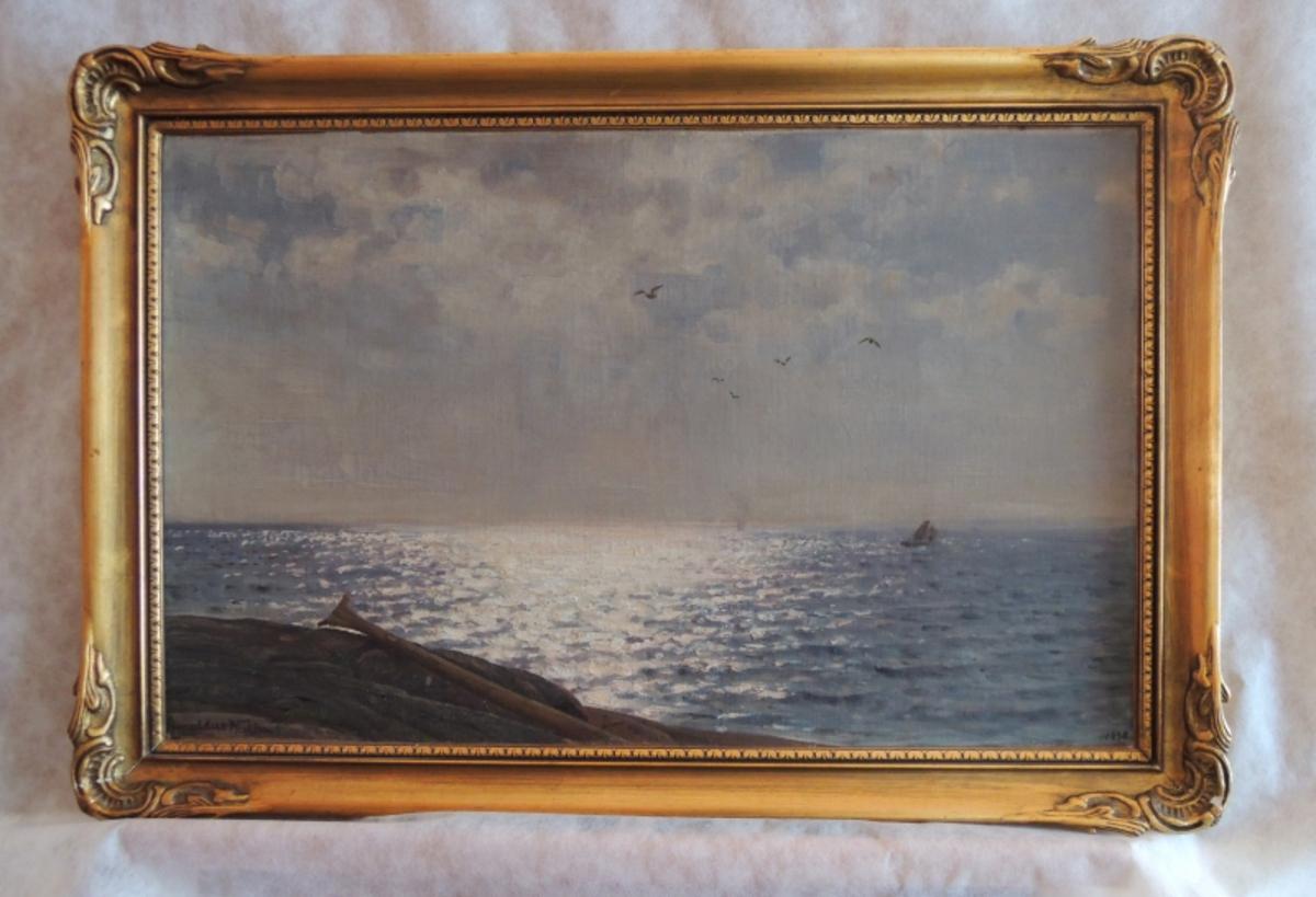 Solspeil med seilbåt.