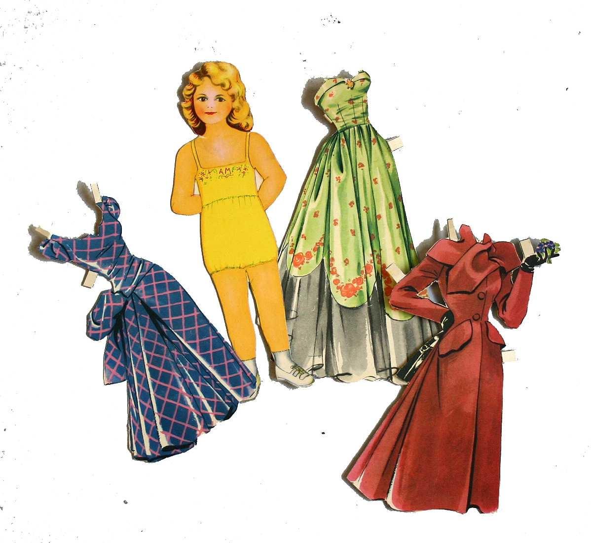 Papirdokker med ulike/diverse klede - nokre kjøpte - nokre teikna av givar.