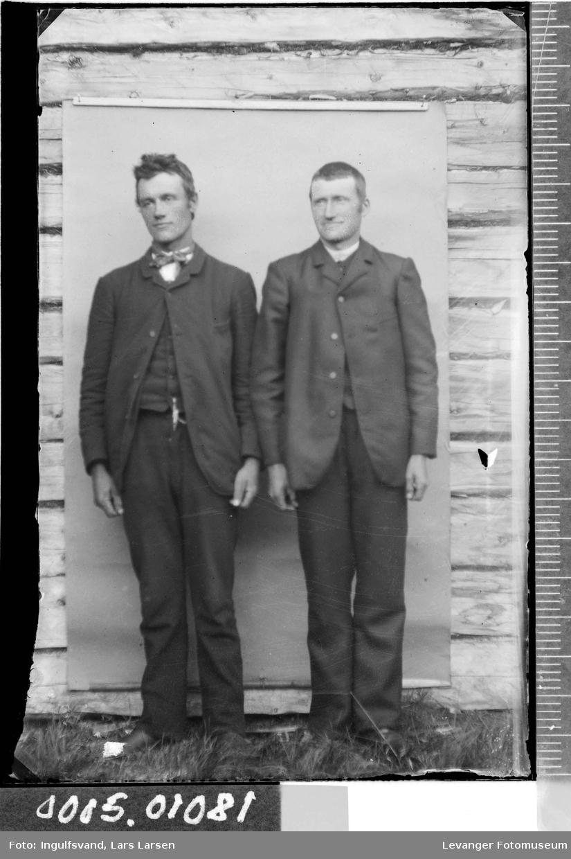 Porttrett av to menn.