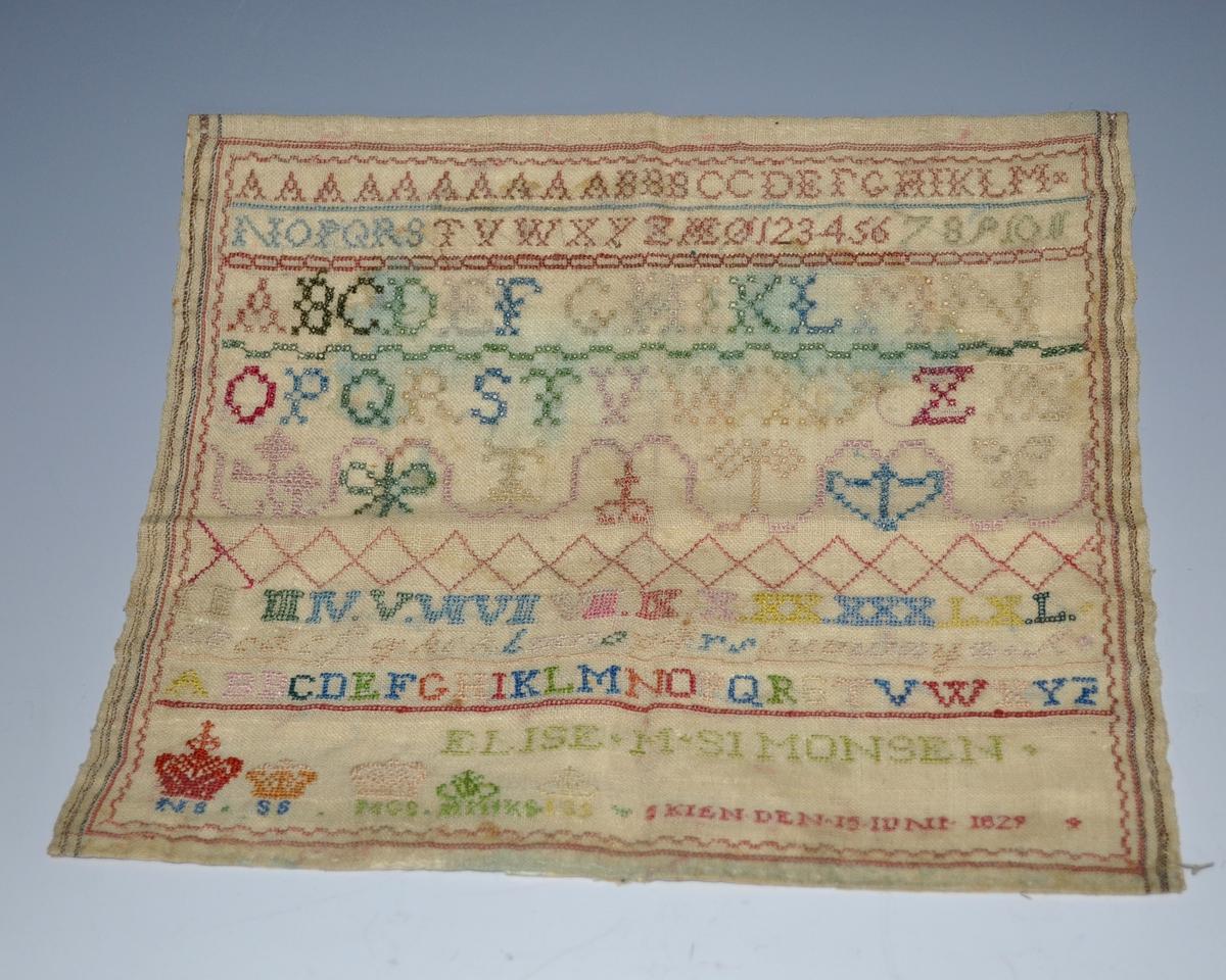 Fra protokollen: Navneduk, sydd av Elise M. Simonsen, dat. Skien den 15. juni 1829.