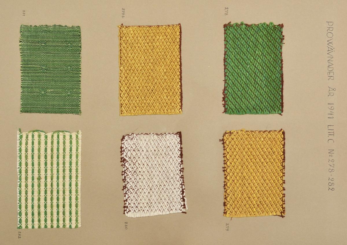 """Stor pappersmapp med lösa blad med påklistrade tygprover. Pärmarna är av en annan papperskvalité än papperna innuti. Pärmarna hålls ihop med ett par långa, handvävda band. Text på framsidan; """"Väfprofer År 1941""""."""