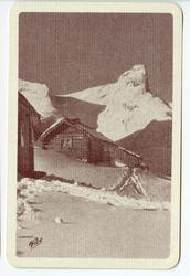 Spillkort. Vinterlandskap med fjell, snø og bebyggelse.