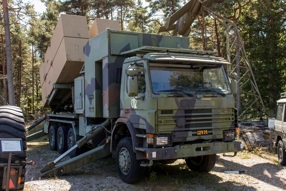 Allmänt: Robotbil 15 KA (Robotbil 8x6) Fabrikat: Scania P113 HK 8x6 L31036Z  Data: Motor: Scania DS 113 Cylindrar: 6 st Effekt: 330 hk Drivmedel: Diesel Tankvolym: 167 liter Förbrukning: 4 liter/mil Elsystem: 24 Volt Kraftöverföring: 16 växlar Fördelningsväxel: Ja Terrängväxel: Ja Differentialspärr: Fram och bak Vinsch: Sidmonterad Dragkraft: 11000 kg med enkel lina