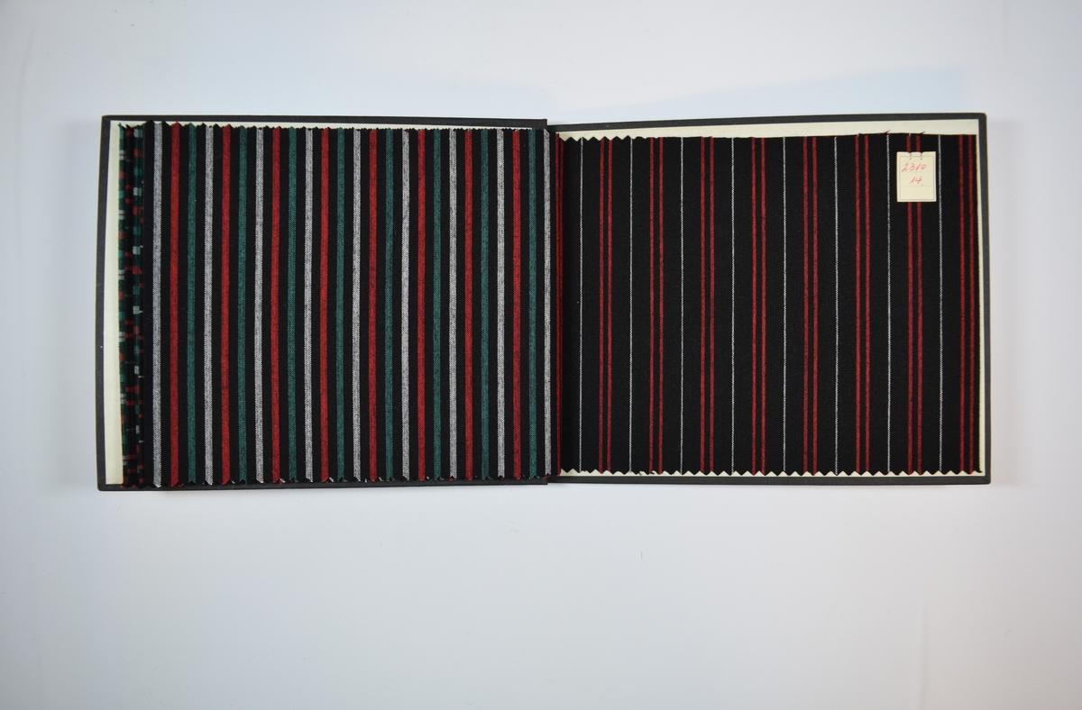 Rektangulær prøvebok med seks stoffprøver og harde permer. Permene er laget av hard kartong og er trukket med sort tynn tekstil. Boken inneholder relativt tynne stoff med rutemønster eller striper. Toskaftsvev. Stoffene ligger brettet dobbelt i boken slik at vranga dekkes. Stoffene er merket med en firkantet papirlapp, festet til stoffet med metallstifter, hvor nummer er påført for hånd.   Stoff nr.: 2310/9, 2310/10, 2310/11, 2310/12, 2310/13, 2310/14.