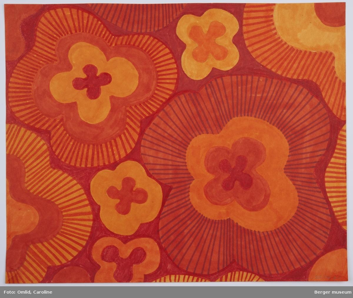 Mønster av blomster med firekronblad innrammet av brede felt rundt, de yttertste skrarvert