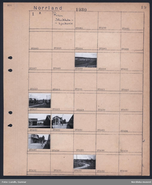 Motiv: Norrland, Resa Stockholm - Lycksele; Landskapsvy med höstack, vy av by, gata med fotgängare och byggnader, kvinna går på grusväg med nedfälld järnvägsbom.