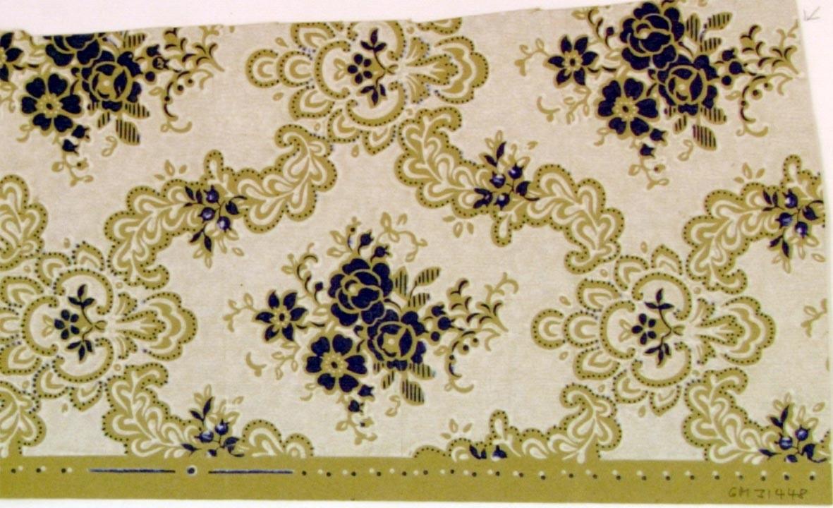 Medaljongmönster dekorerat med blommor i ultramarin på en vit bakgrund. Ljusgrått genomfärgat papper.