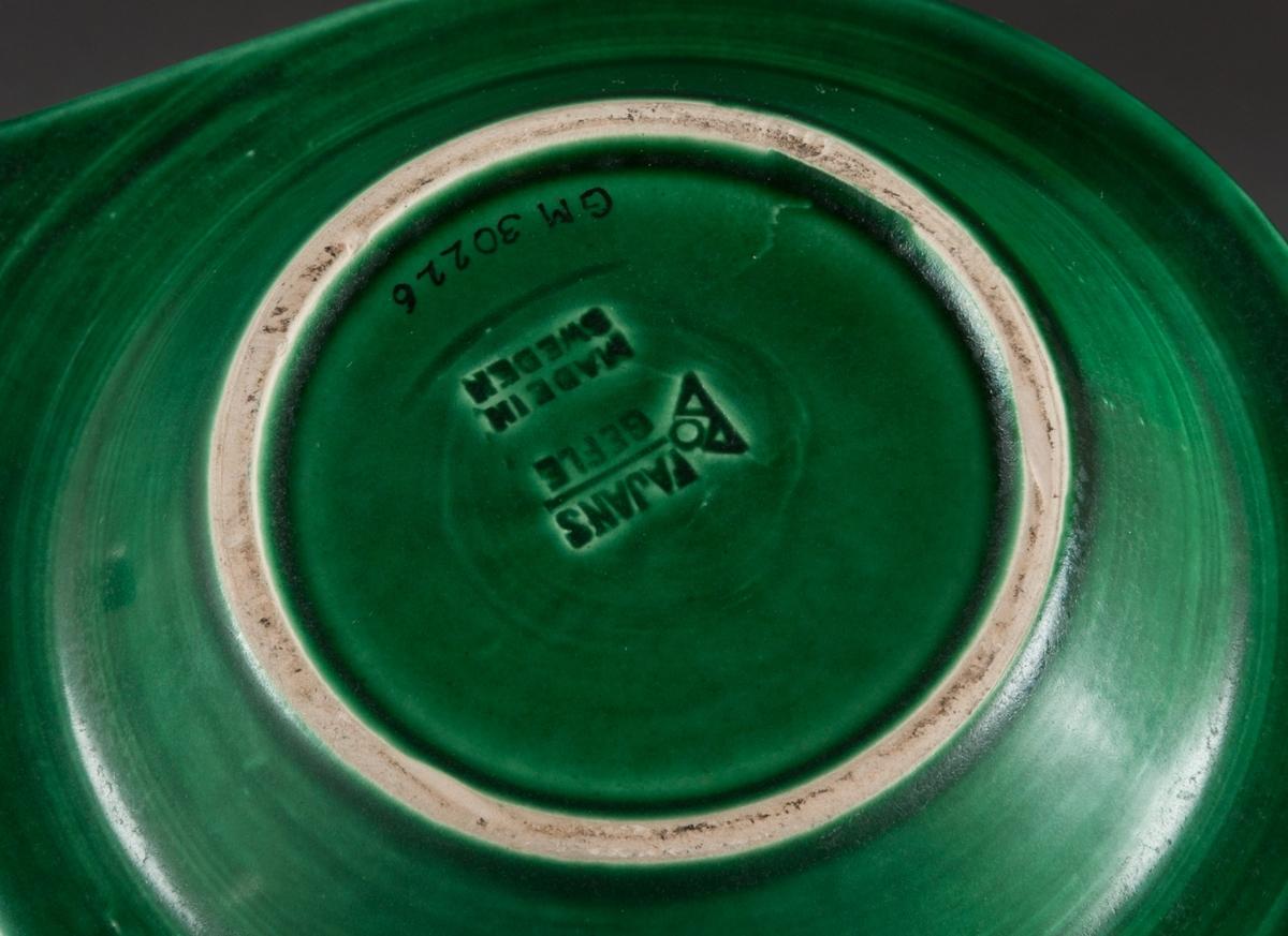 Askfat. Grönglaserat askfat tillverkat vid Bo Fajans i Gävle. Tillverkat för järnhandelsfirman Jacob Wennberg Akt.bol.