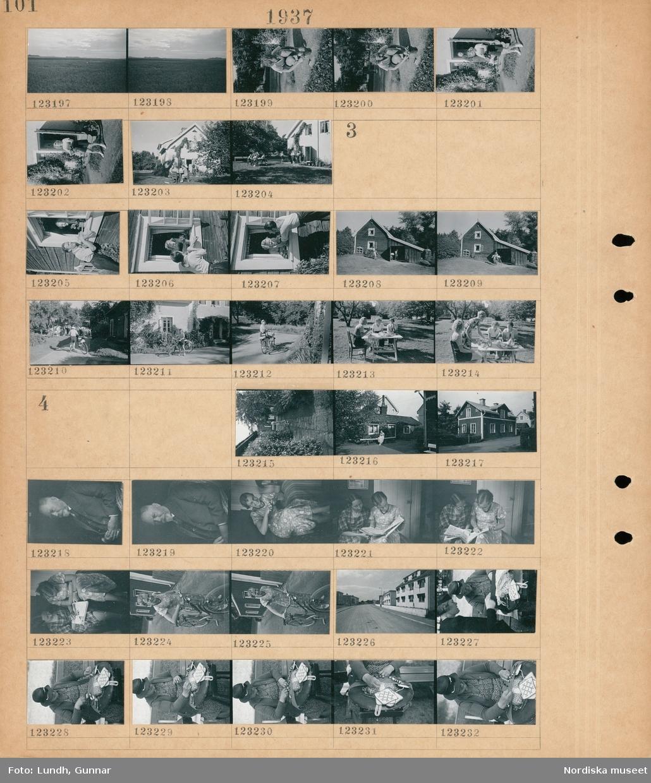 Motiv: Östergötland, Vadstena; Landskapsvy med åkrar och himmel, en kvinna och en man vid ett hus, människor i en trädgård vid ett hus.  Motiv: (ingen anteckning) ; En kvinna och en man vid ett öppet fönster, exteriör av ett hus, en kvinna med cykel, fyra kvinnor dricker kaffe vid ett trädgårdsbord.  Motiv: (ingen anteckning) ; En kvinna i en trädgård, en kvinna sitter på en bänk framför ett hus, exteriör av ett hus, porträtt av en man, porträtt av två kvinnor som läser en tidning, stadsvy med hus, en en kvinna med en cykel, kvinna som knypplar.