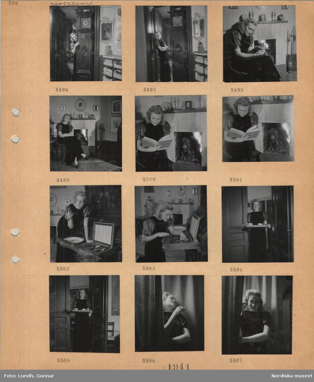 Motiv: Modell i klänning som poserar, står vid ett golvur, sitter vid en öppen spis med brasa och läser, hanterar bestick i ett schatull, står i en dörröppning med en bricka med koppar, står och röker.