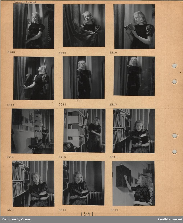 Motiv: Modell i klänning som poserar, står och röker, står och läser i en bok, står vid draperier, står vid en bokhylla och läser en bok, radio, sitter vid en bokhylla och läser en bok, öppnar ett litet väggskåp.