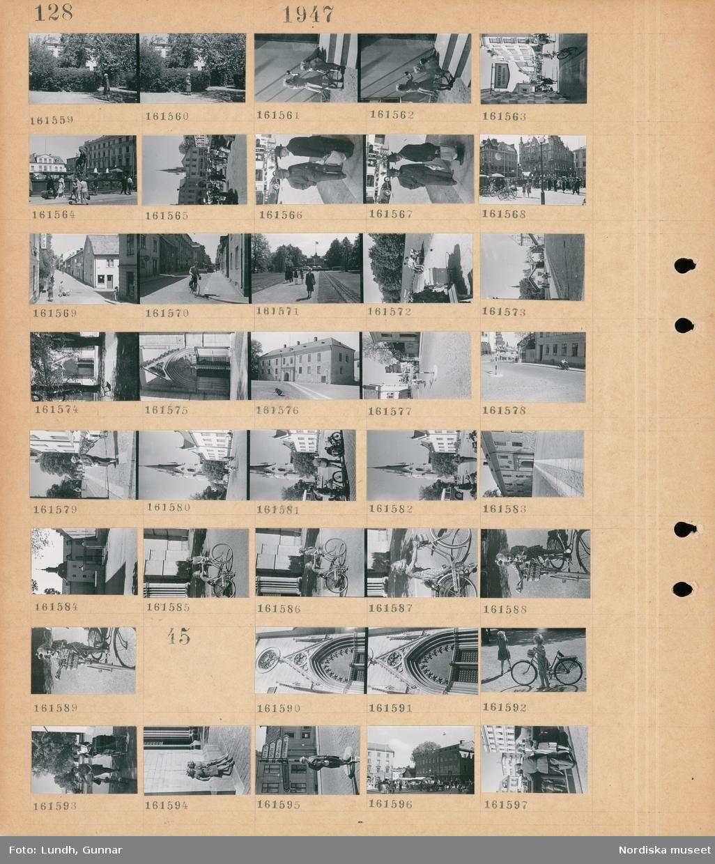 """Motiv: (ingen anteckning) ; En kvinna i en park möjligen Ester Lundh, en flicka och ett barn kastar boll mot en vägg, stadsvy med fotgängare och en skylt """"Aeimertohn Körsnärsfirma"""", stadsvy med fotgängare, stadsvy med en cyklist, en port, exteriör av hus, en vägskylt, porträtt av en kvinna möjligen Ester Lundh, stadsvy med en kyrka, två flickor med en cykel, en flicka med en cykel med en cykelkorg.  Motiv: (ingen anteckning) ; Detalj av en kyrka, två flickor med en cykel, två kvinnor med en cykel och en barnvagn, två flickor står lutade mot en vägg, vägskylt """"Norrköping Kisa Mjölby Örebro Borensberg"""", ett torg med torghandel, en man i uniform och en kvinna."""