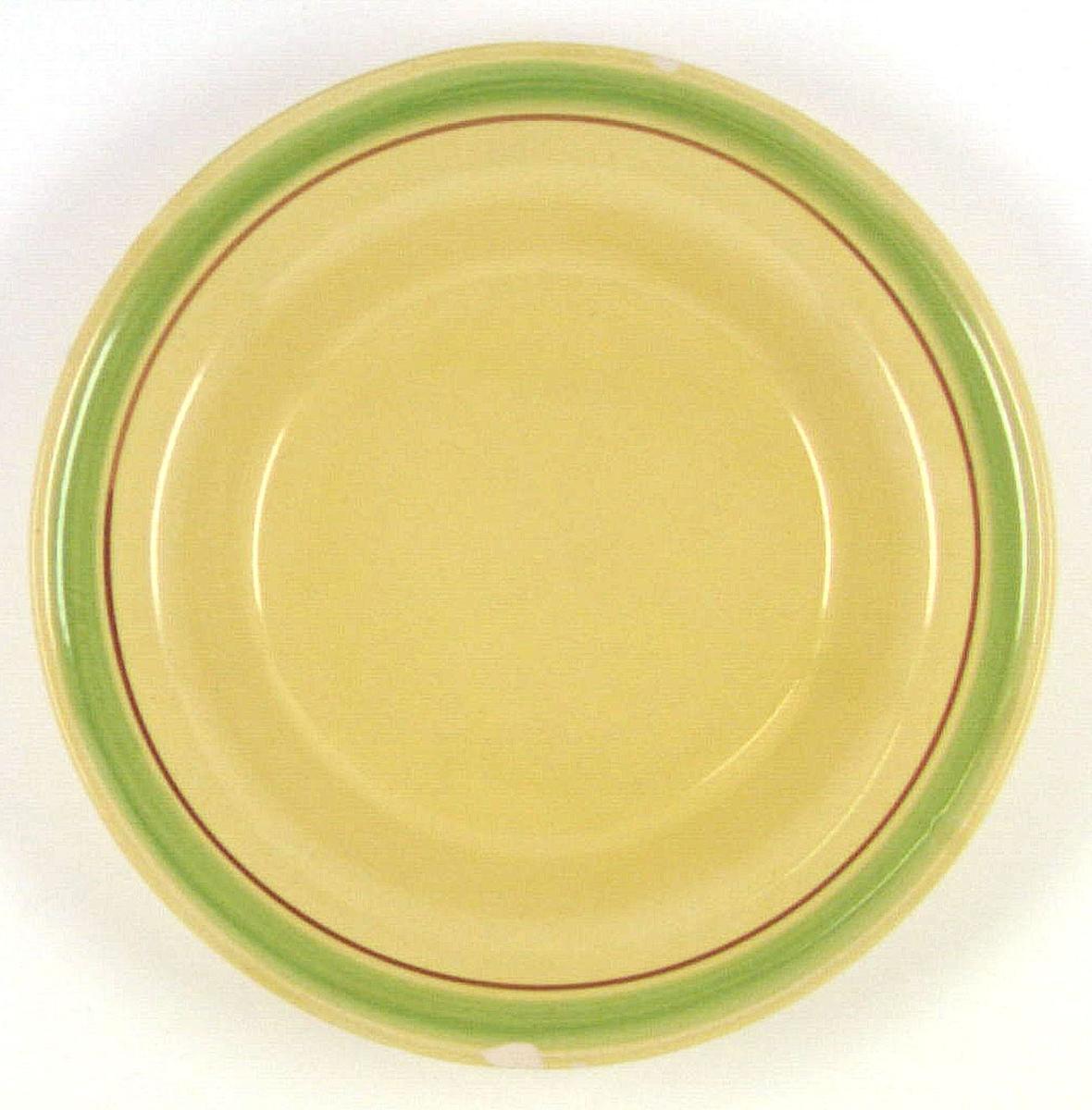 Djup mattallrik tillverkad vid Bo Fajans. Försedd med glasyren Viva, gul med handmålad rand i grönt och brunt. Glasyren användes 1939-1943. PÅ undersidan finns följande text: Termo Bo Fajans Gefle, Made in Sweden 1732/3 Viva.