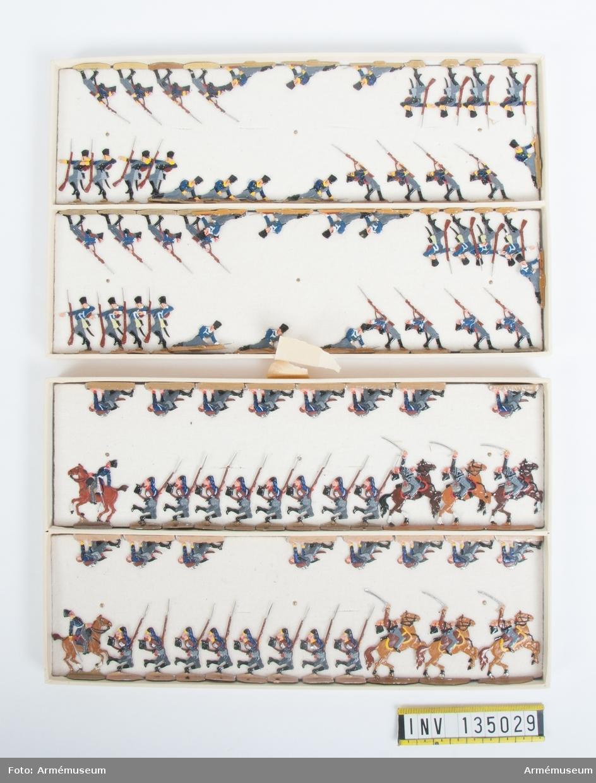 Infanteri, fallande och stupade från Preussen från Napoleonkrigen. Två lådor med figurer. Fabriksmålade.