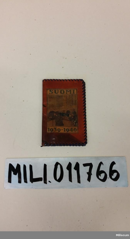Plånbok av färgat läder.