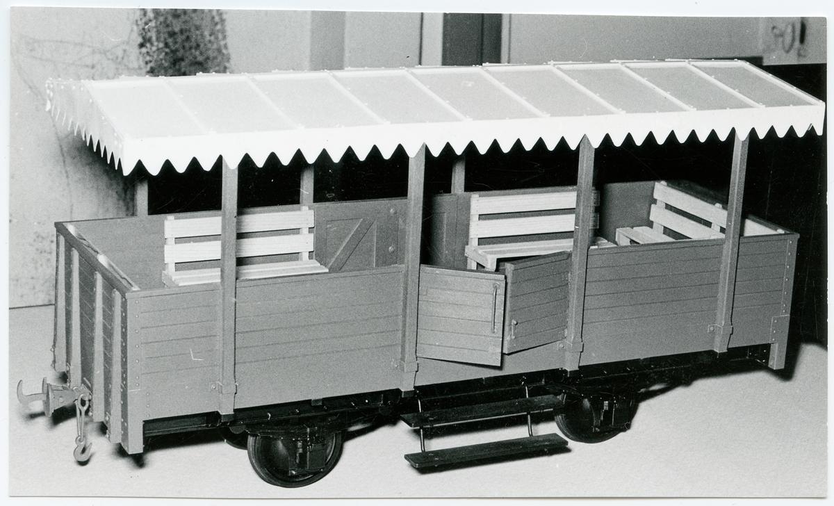 Modell av en sommarvagn.
