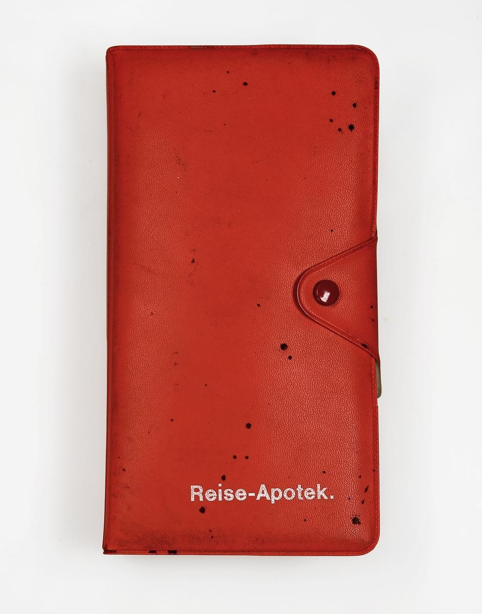 Plastetui med enkelt førstehjelpsutstyr