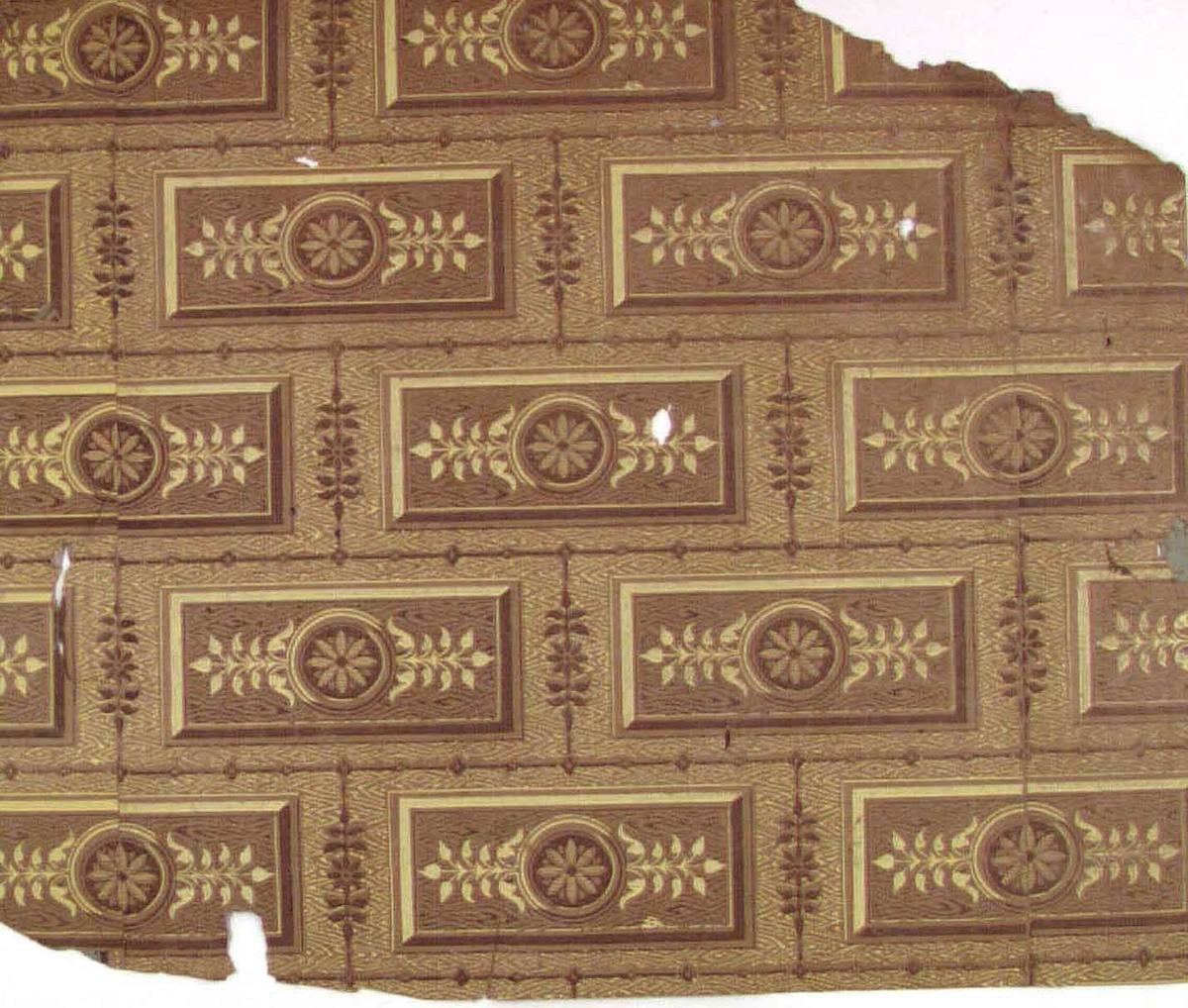 Träimiterande mönster med blomdekorerade rutor lagda som tegelstenar. Tryck i citrongult och brunt på ett ljusbrunt genomfärgat papper.