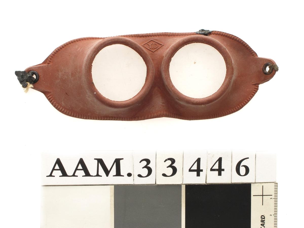 Svømmebriller av brun myk plast med runde glass.