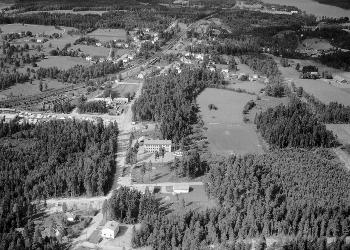 Flygfoto över Flisby i Nässjö kommun, Jönköpings län. 1180/1962