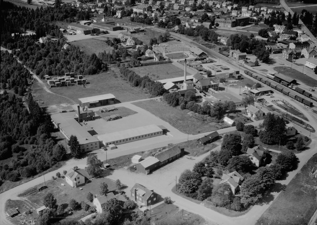 Flygfoto över Smålandsstenar i Gislaveds kommun,  Jönköpings län. 1234/1964