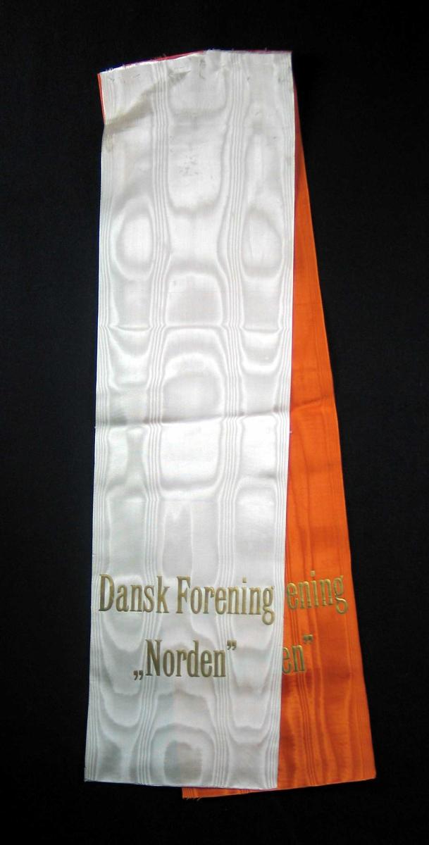 Silkesløyfe i hvitt og oransje.
