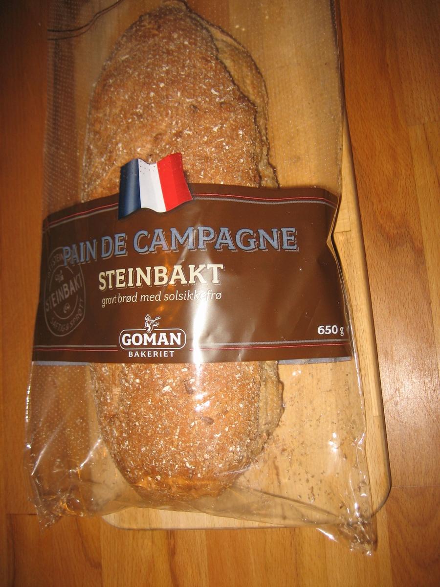 Motiv på posen er et fransk flagg. Den er plassert øvert på et brunt belte, som går tvers over posen