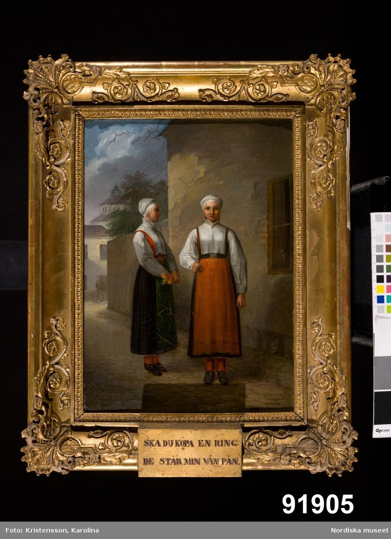Två unga kvinnor i Moradräkt, troligen från Våmhus som säljer ringar av hår eller möjligen tagel med inlagda deviser. /Berit Eldvik 2012-03-09