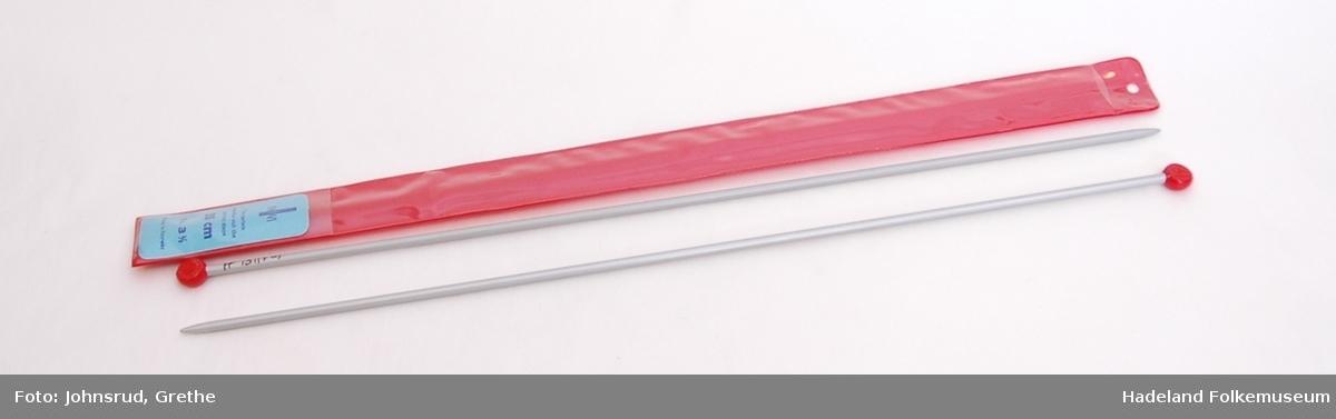 To langpinner pakket i original emballasje, avlang plastlomme, gjennom siktig på ene siden