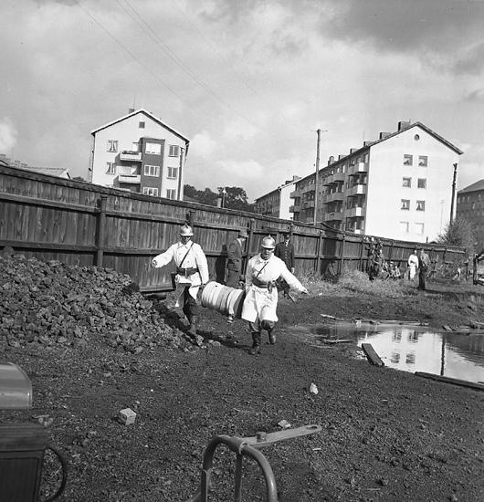 """Enligt notering: """"Brandövning vid gamla gasverket d. 22/9 57""""."""
