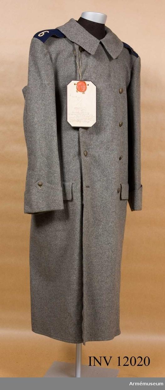Grupp C I. Deposition från Arméförvaltningens intendenturdepartement, modellkammaren. Modell å kappa m/1910 för manskap med vederlikar vid alla truppslag, fastställd genom g.o. den 23 december 1910 n:r 1379.