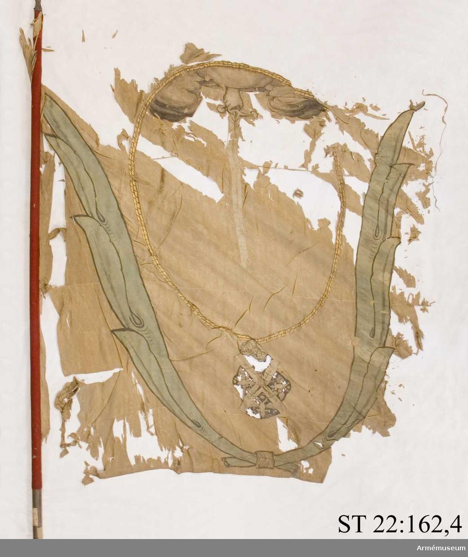 På tredje våden närmast strumpan finns del av en röd stämpel (kinesisk?).