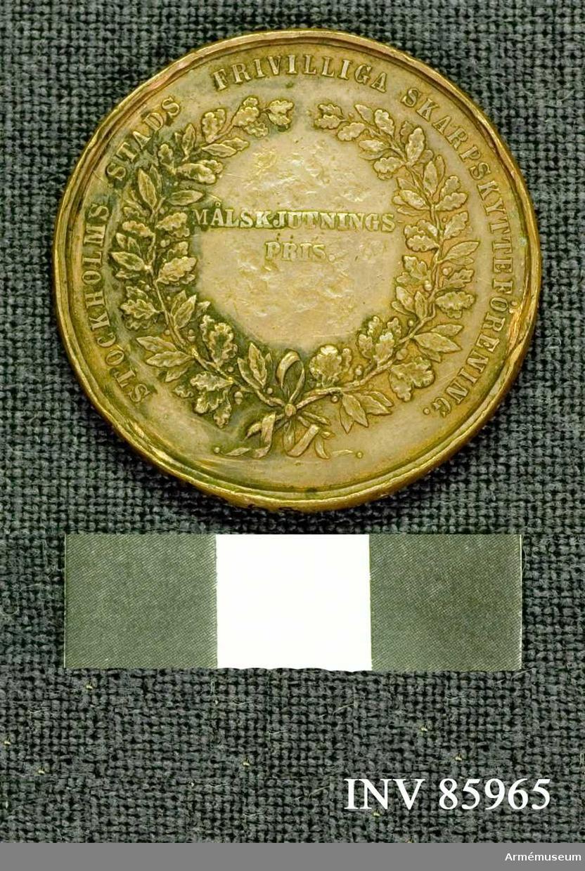 Grupp M.. Åtidan: Lika med nr: 16267. Frånsidan: Lika med nr: 16267 med undantag att intet namn är inristat å medaljen.