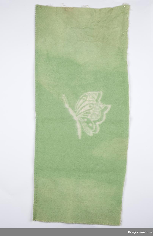 Hvit sommerfugl på grønn bakgrunn. Dobbeltvevd.